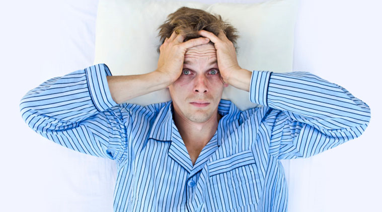 Anxiety causing man to lose sleep.